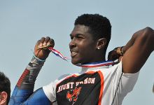 Sam Bethea holds up his State Champion medal.