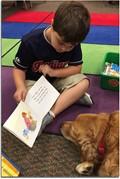Twin Oak student reading to Sandy