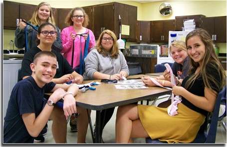 Family, Career, and Community Leaders of America students making dog toys for the Knox County Animal Shelter.