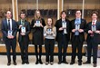High School Debate Team with State Qualifier Plaques