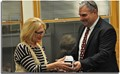 Superintendent William Seder recognizing Cheryl Feasel for her exceptional service on the Board of Education.