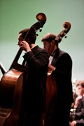 Two Mount Vernon High School Orchestra members playing bass.