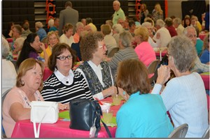 Senior Citizens enjoying lunch with high school students.