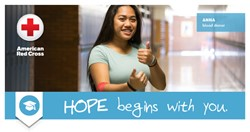 Student giving the thumbs up for giving blood during the blood drive.