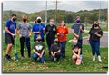 Key Club members standing with planting shovels.