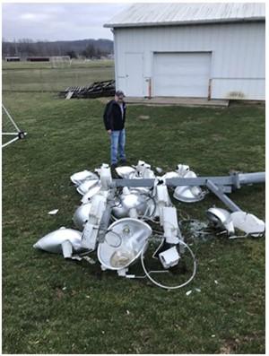 Supervisor, Rick Shaffer assessing the downed stadium light pole.