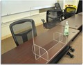 Plexiglass barrier installed on conference desk.