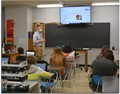 Ryan Shoemaker instructing students in Biology class during opening week.