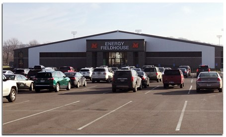 Parking lot and entrance to Energy Fieldhouse.