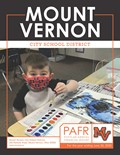 Student painting with water colors on the cover of the Popular Annual Financial Report.