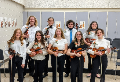 The 2021 Orchestra Seniors pose in two rows for a photograph with their instruments.