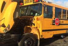 School Bus in repair with the hood raised.