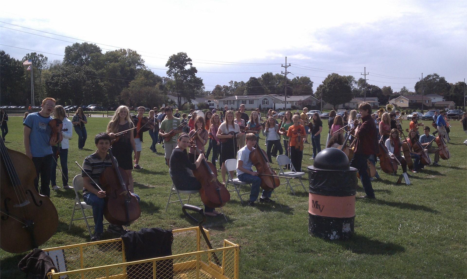 Orchestra students practice on the marching band field.