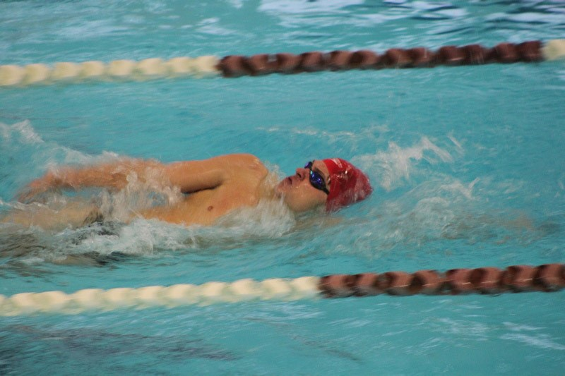 MV Swimmer competing in backstroke event.