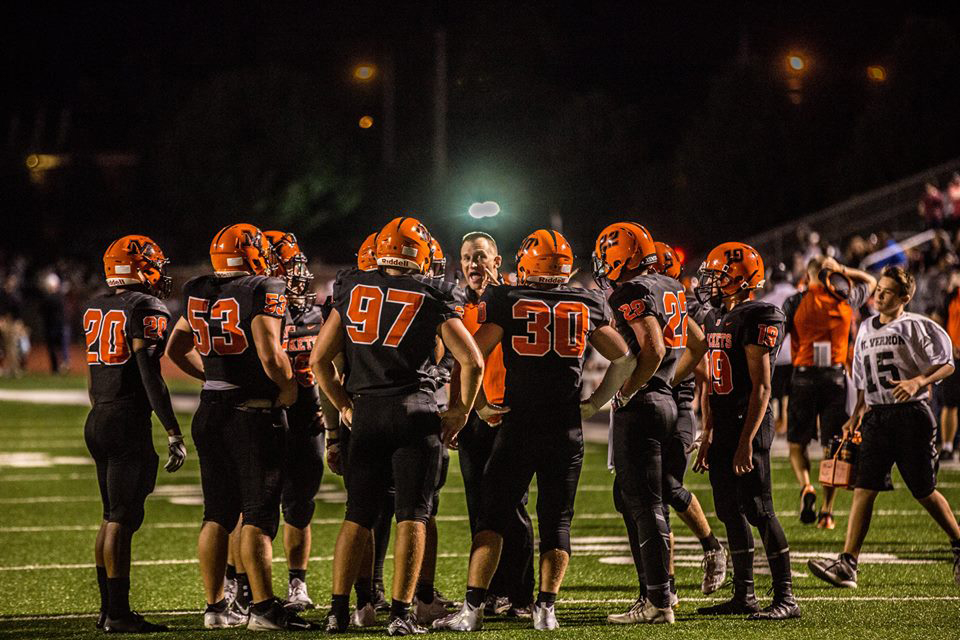 Coach Kerr encourages the Jacket Football players.