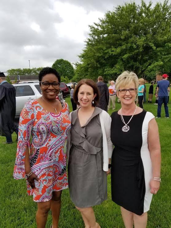 three counselors posing at graduation 2017