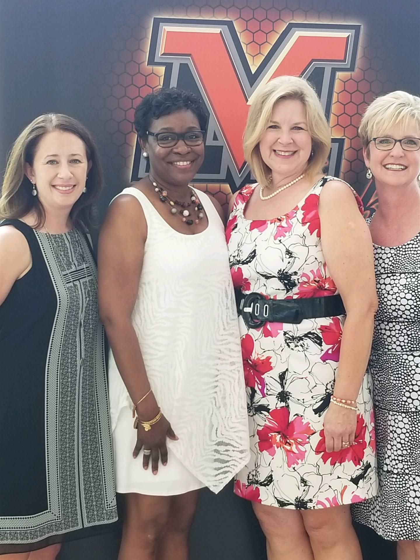 Mrs. Fawcett, Mrs. Kennerly, Mrs. Szenas, and Mrs. Wihl at graduation 2018