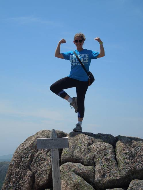 Mrs. Torgler climbing the highest mountain in Maine.