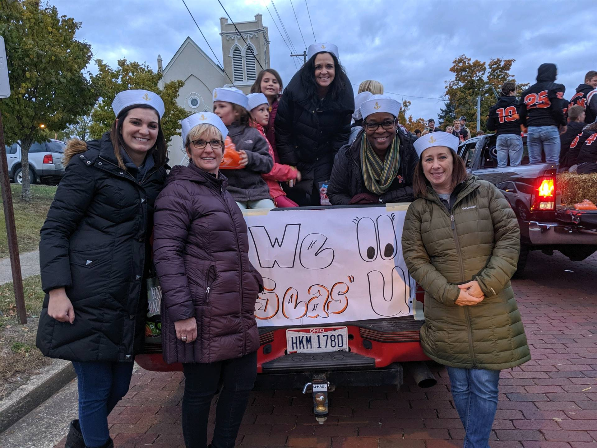 counselors standing by truck for homecoming parade