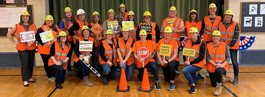 East Elementary teachers in hard hats and orange vests.