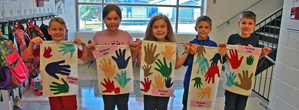 "Columbia students displaying their ""My Family' artwork."