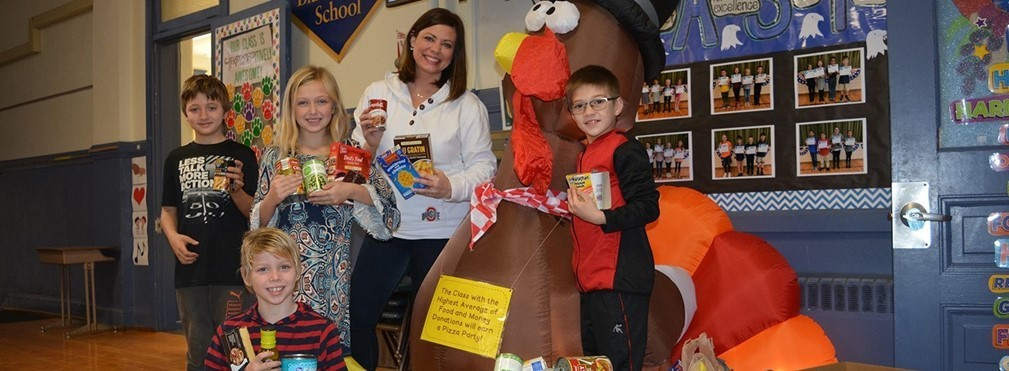 East Elementary Principal Karly Watterson with students during the Food For The Hungry Drive.