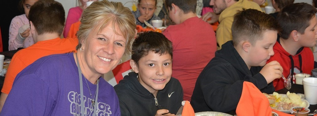 Mrs. Ferguson and student enjoying Columbia's Thanksgiving Lunch.