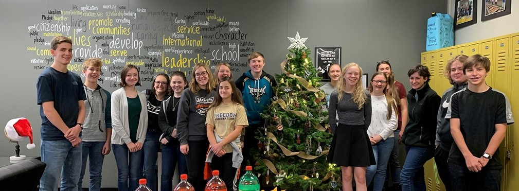 Students in Mrs. Keaton's Hive with Christmas Tree.