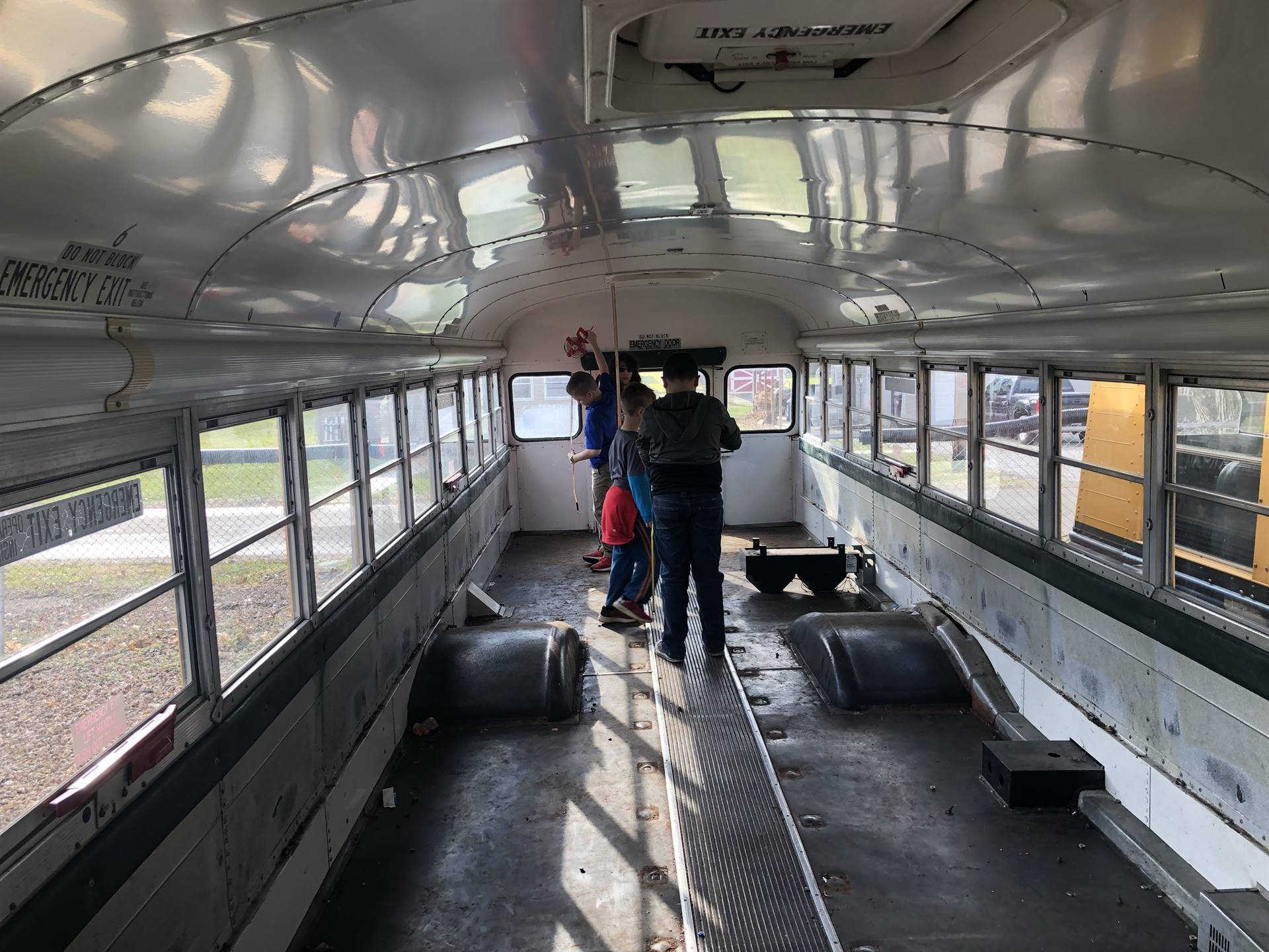 Students exploring the bus.