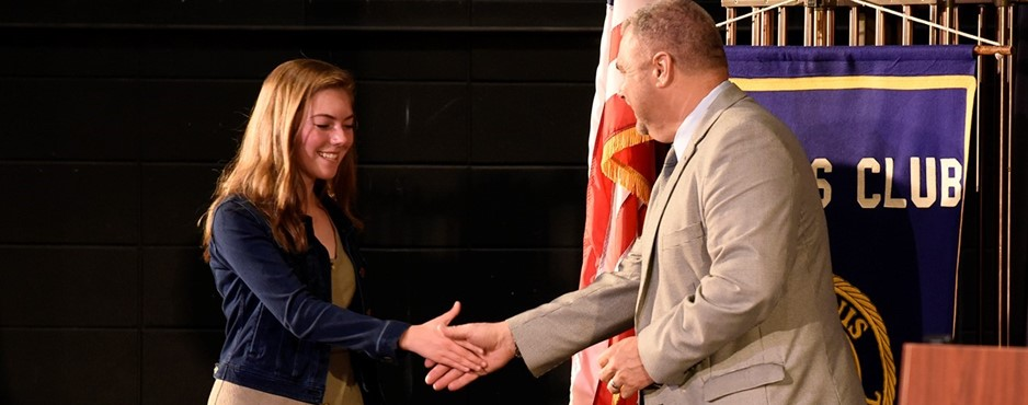 Superintendent William Seder congratulates student during the Scholastic Recognition Program.