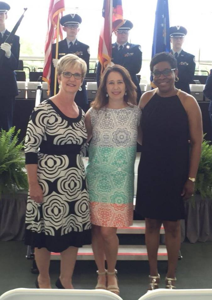 three counselors standing at graduation 2019
