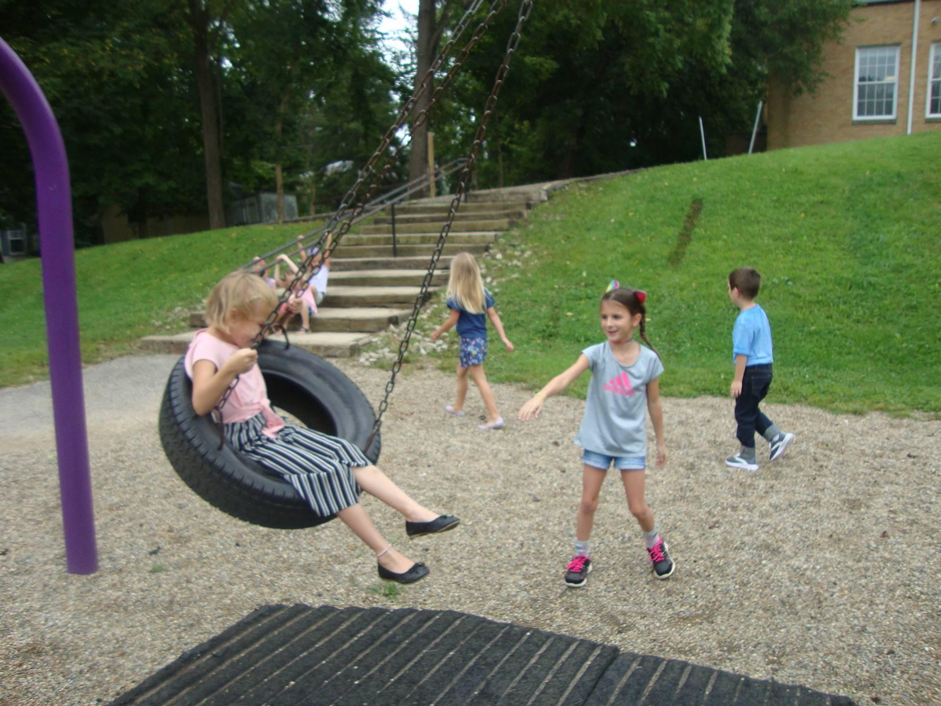 kids on tire swing