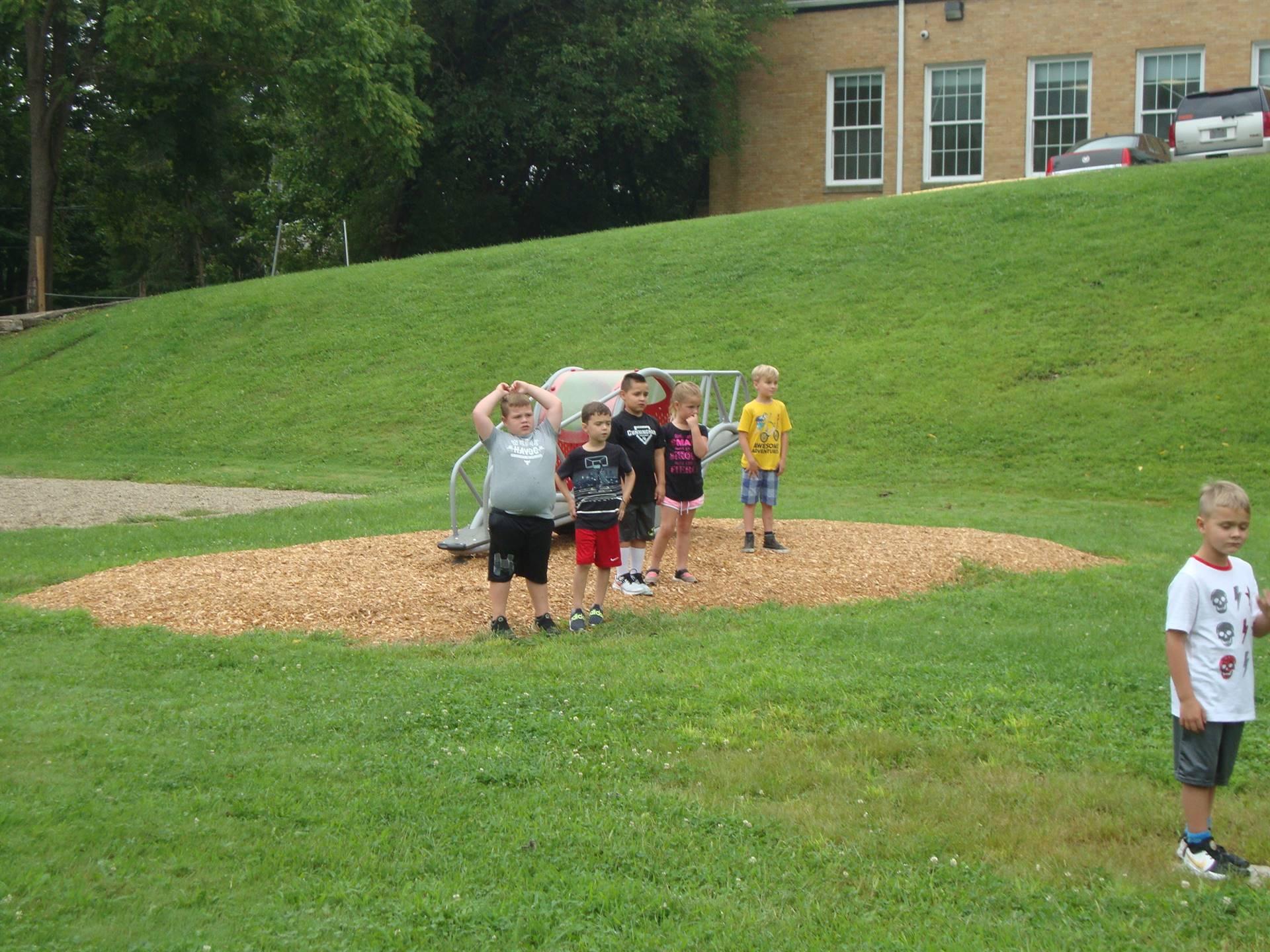 kids playing kickball