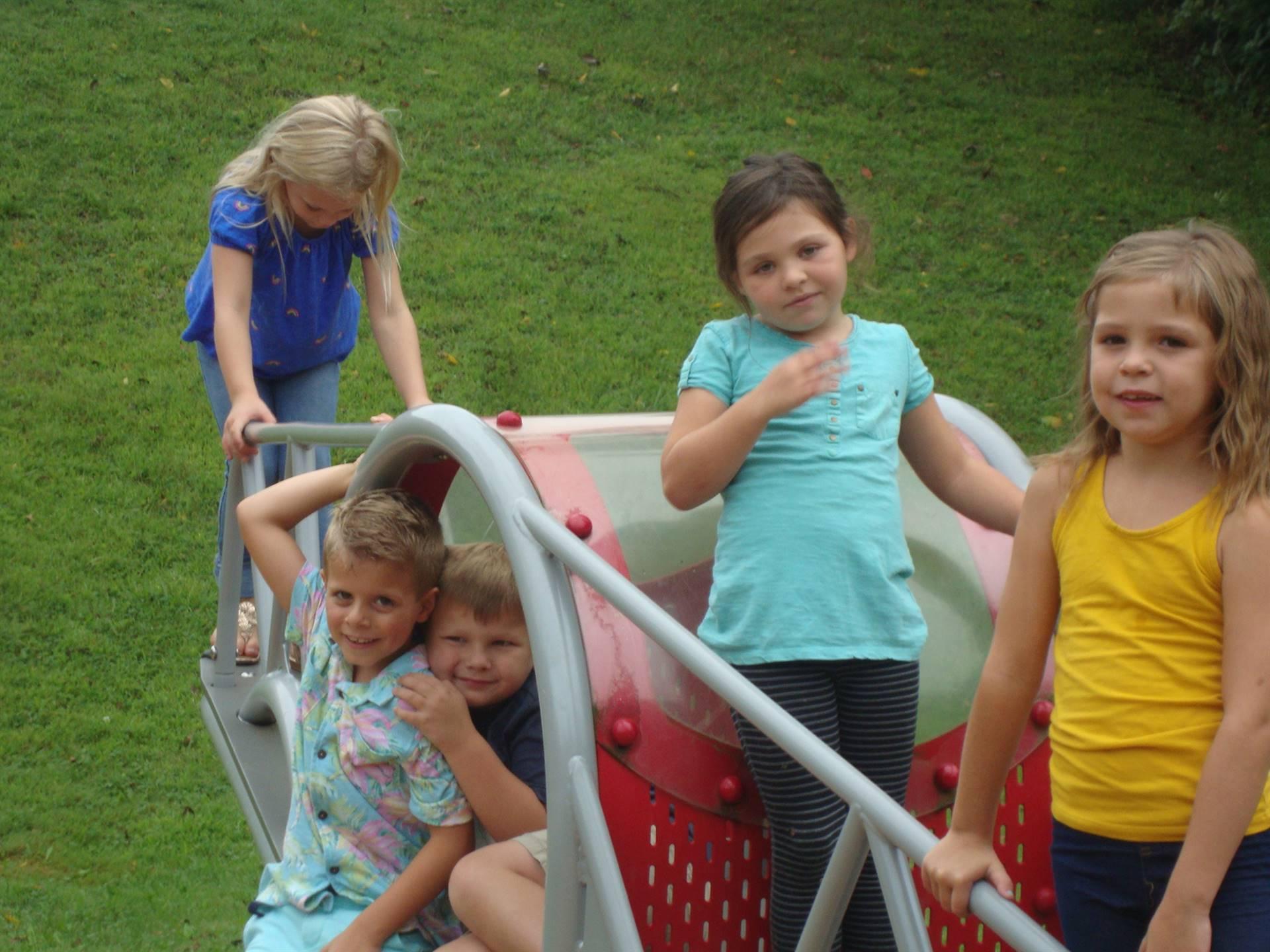 4 girls on teeter totter