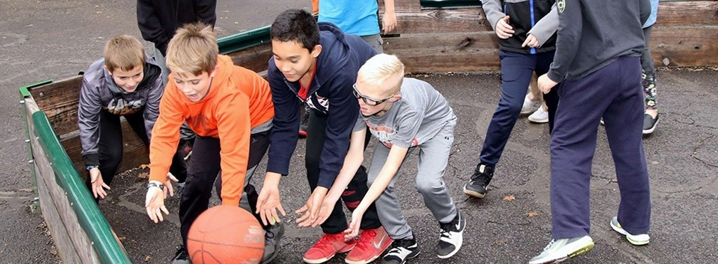 Students playing Ga Ga Ball on the playground.