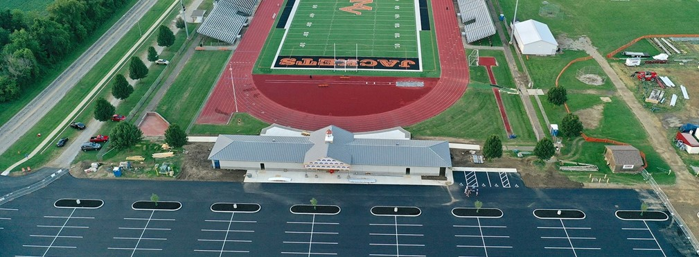 Aerial view of stadium entrance and parking lot nearing completion.