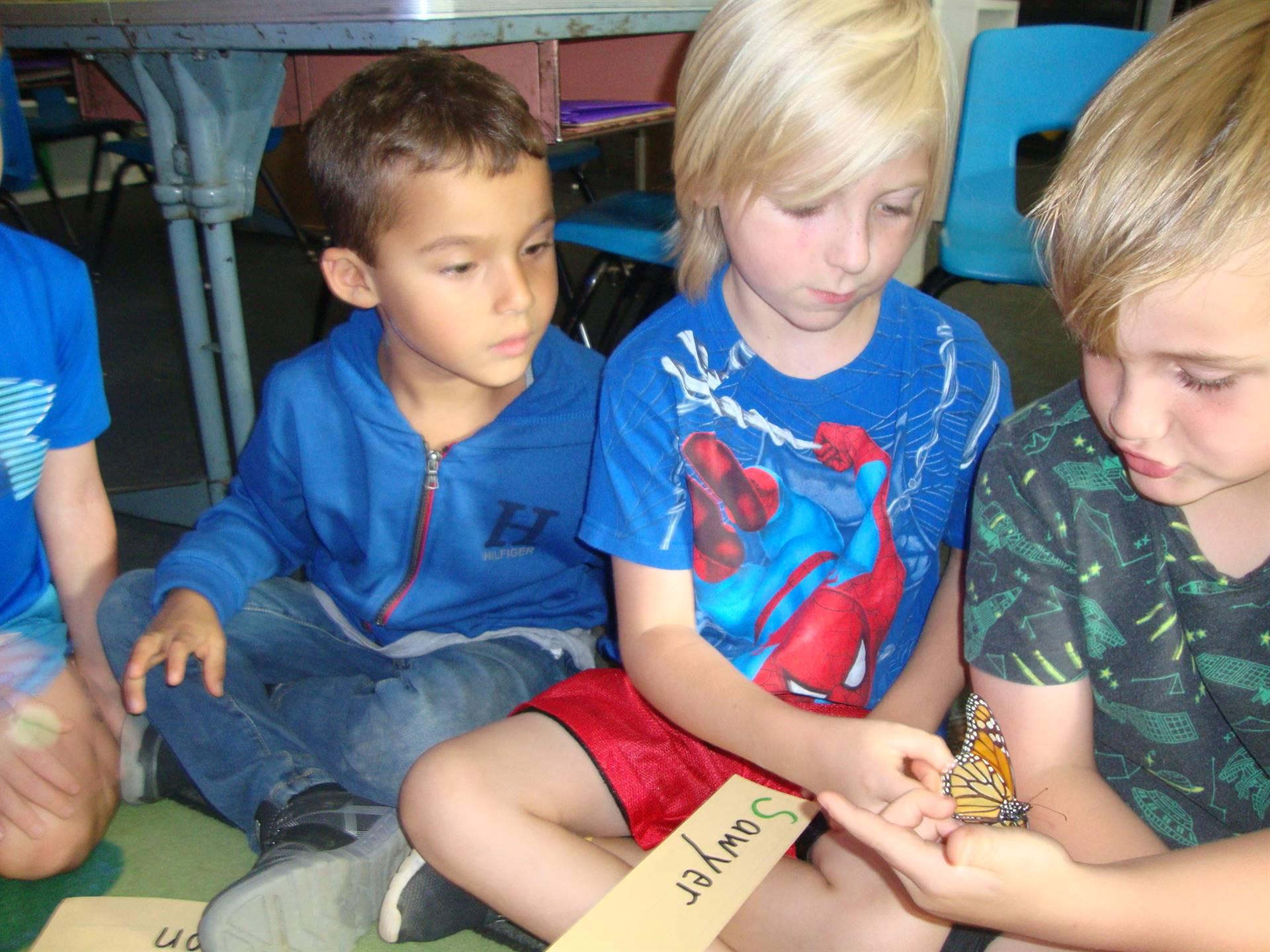 children holding monarch