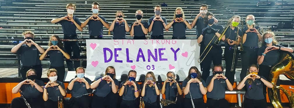 MVHS Band supporting Delaney in front of the stadium.