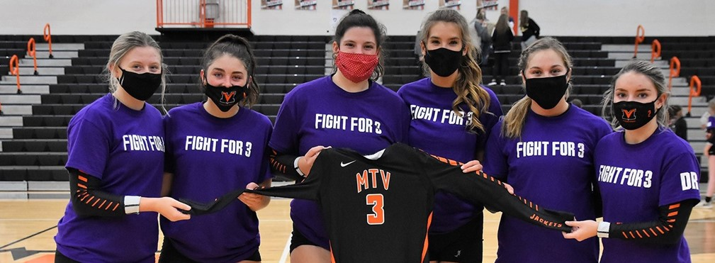 Mount Vernon Volleyball players holding Fight For 3 jersey.
