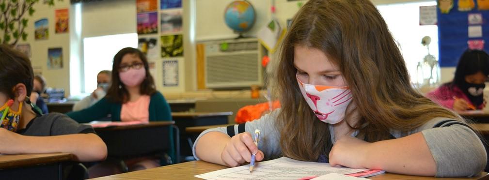 Dan Emmett elementary student working at her desk.