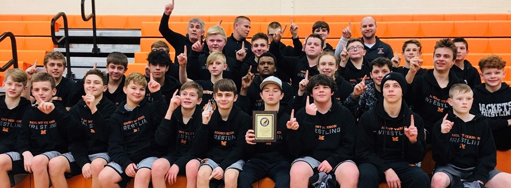 Middle School Wrestling Team with conference championship plaque.