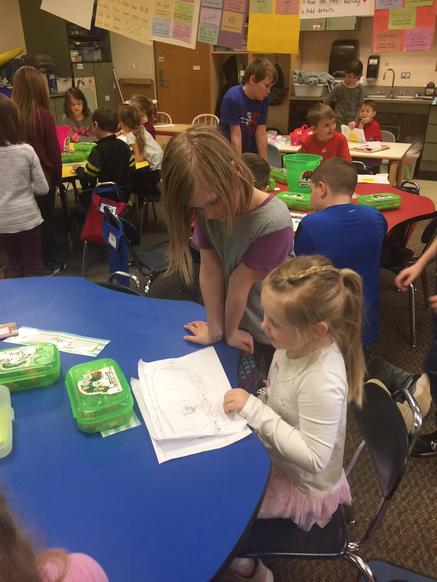 Helping our kindergarten friends celebrate their writing!