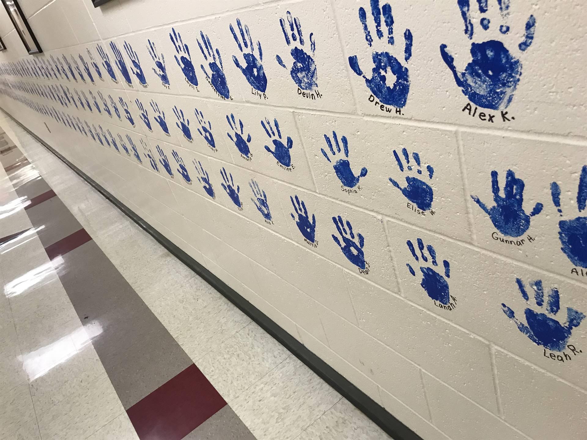 Hands in the hallway.