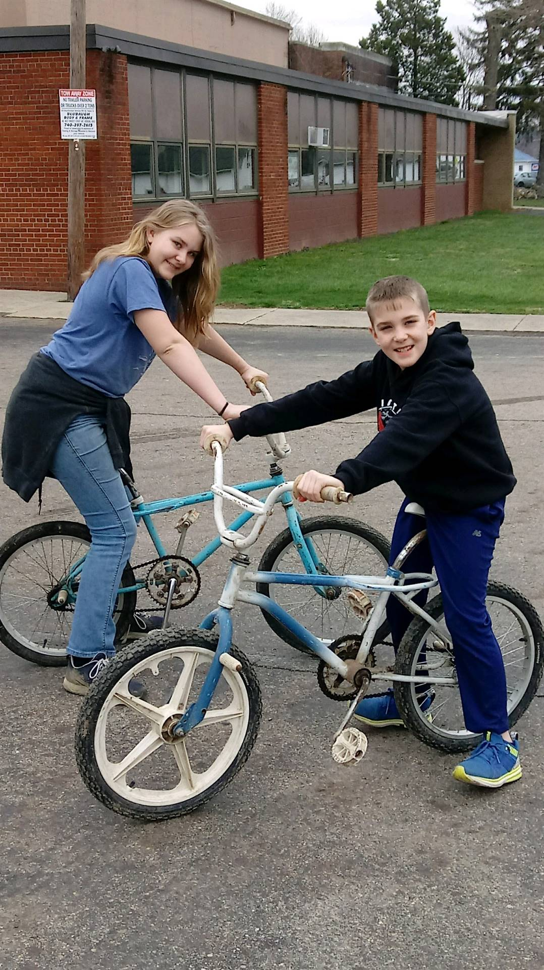 Boy and a girl on bicycles
