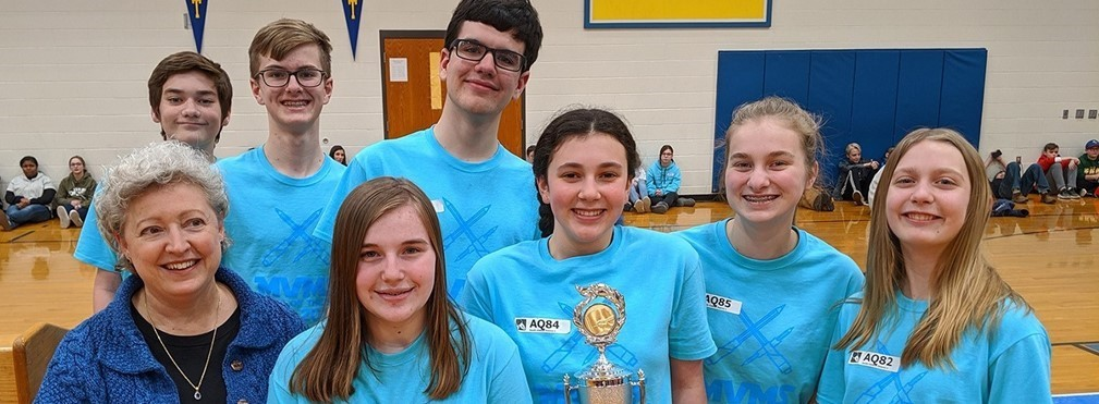 Eighth Grade Power of the Pen Team with First Place District trophy.