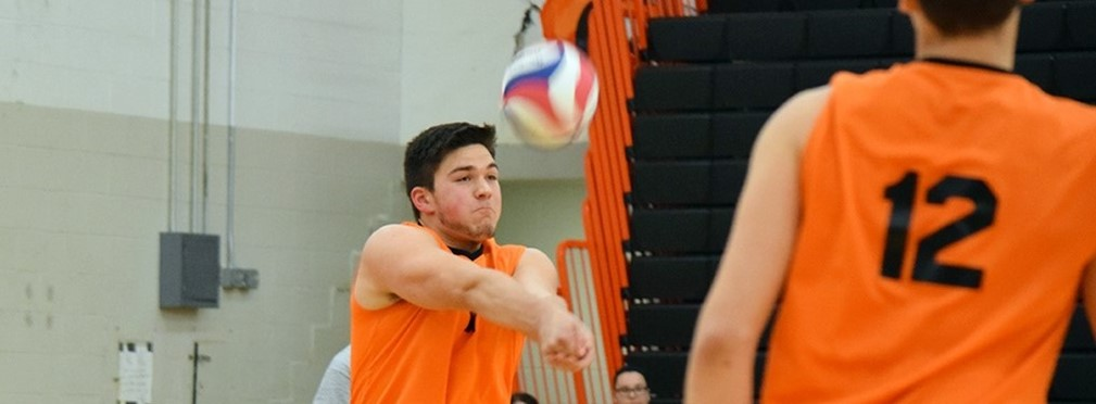 Boys Volleyball player setting the ball.