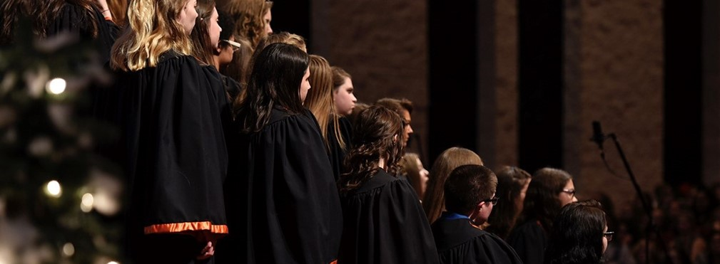 Choir members performing.