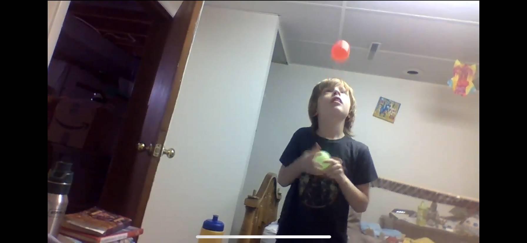 Boy Juggling