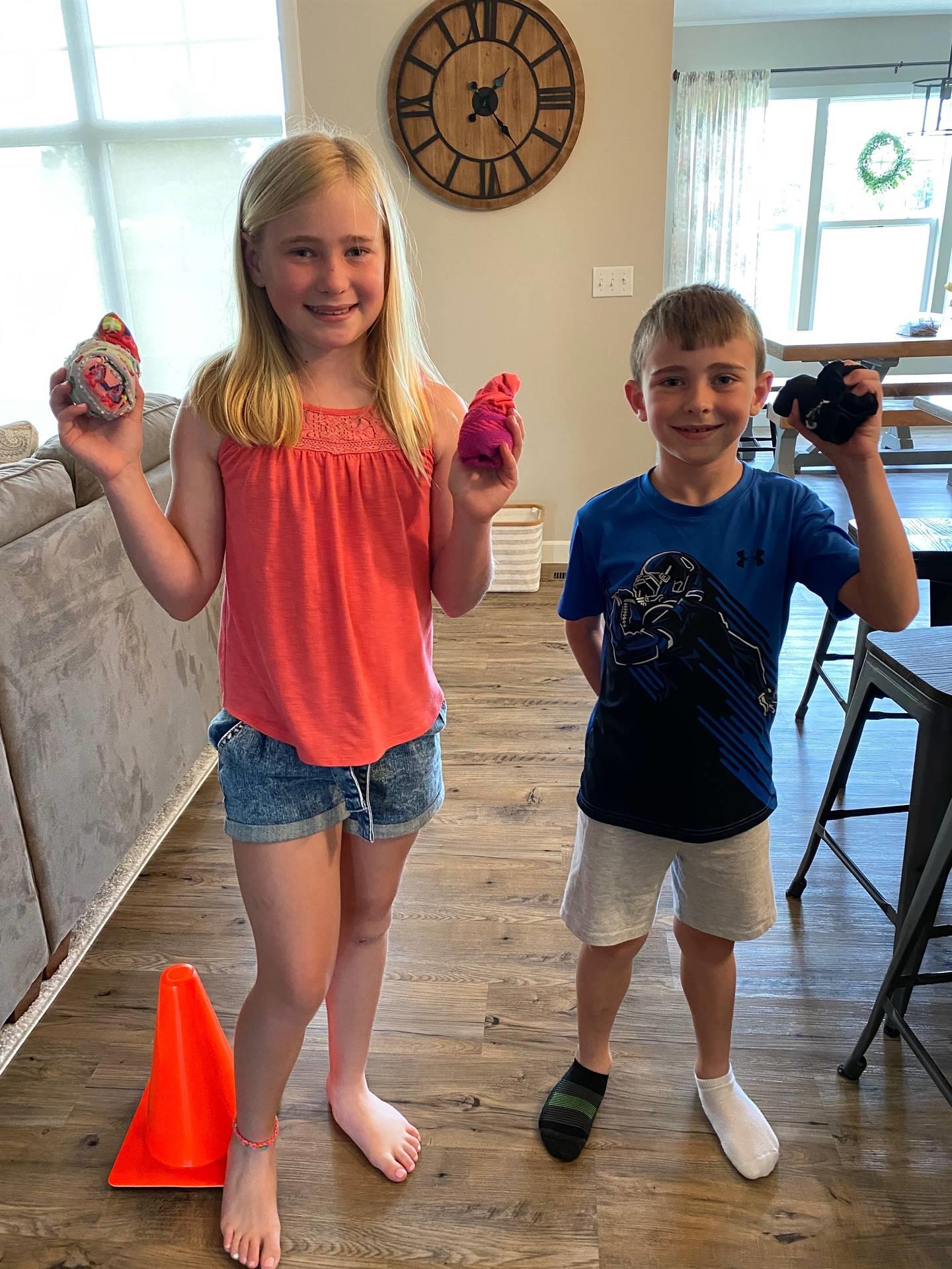 boy and girl holding sockballs