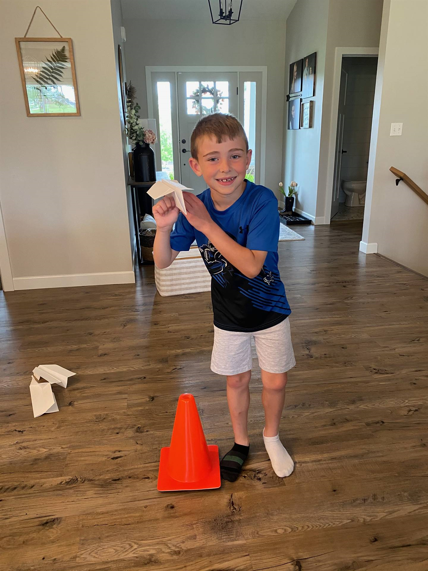 boy holding paper airplane